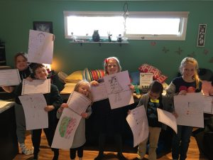 Kids Reiki Workshop. 6 kids holding their chakra art and their Reiki certificates.